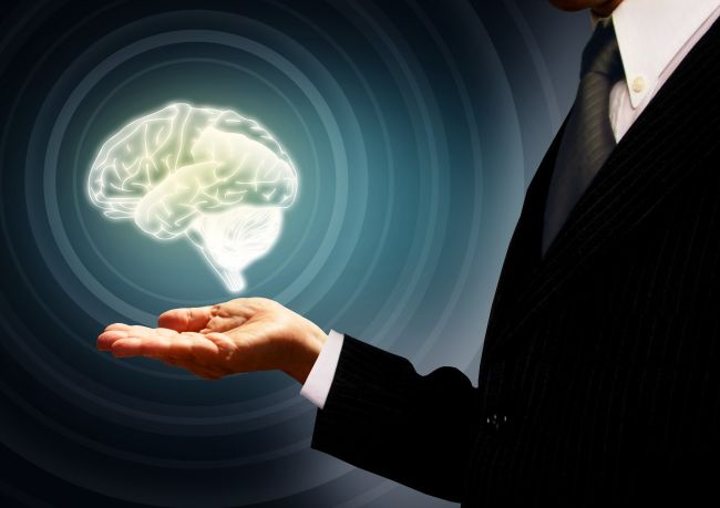 illustration of a man holding a brain hologram in his palm, representing artificial intelligence
