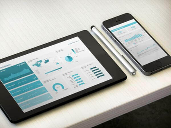 Tablet and smartphone displaying dashboards on their screens