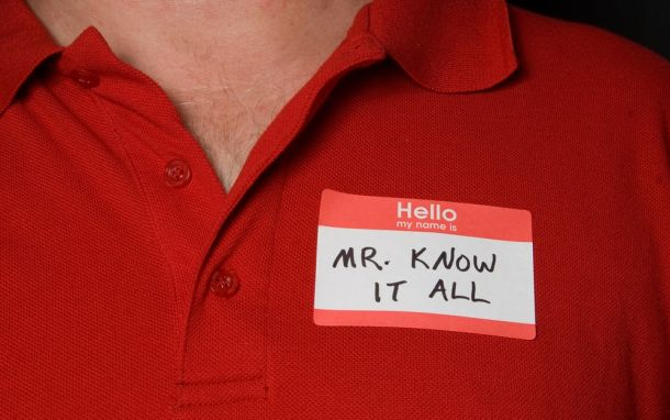 """Image of a manager with """"Mr.Know-It-All"""" title"""