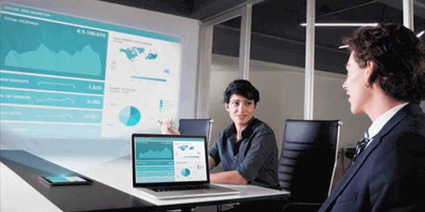 woman presenting dashboard to her colleague